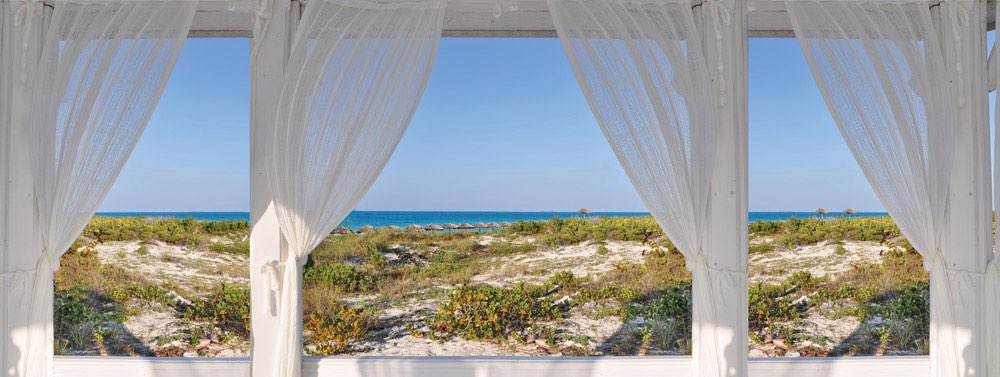 Tropical view on beach and blue ocean with white waving curtains in front