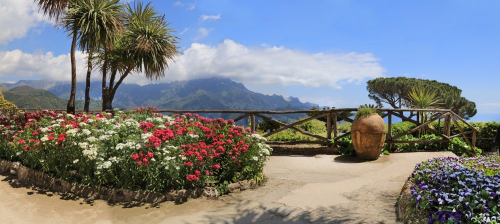 Island balcony with colourful flowers and lookout at mountain