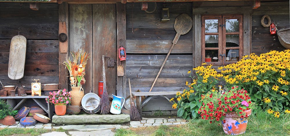 Wooden barn with flowers, pots, candles, ...
